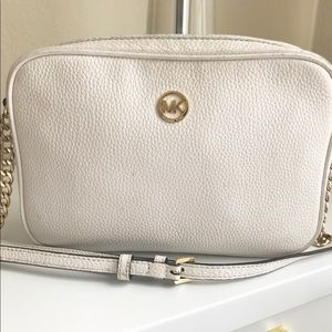White Michael Kors crossbody with gold details